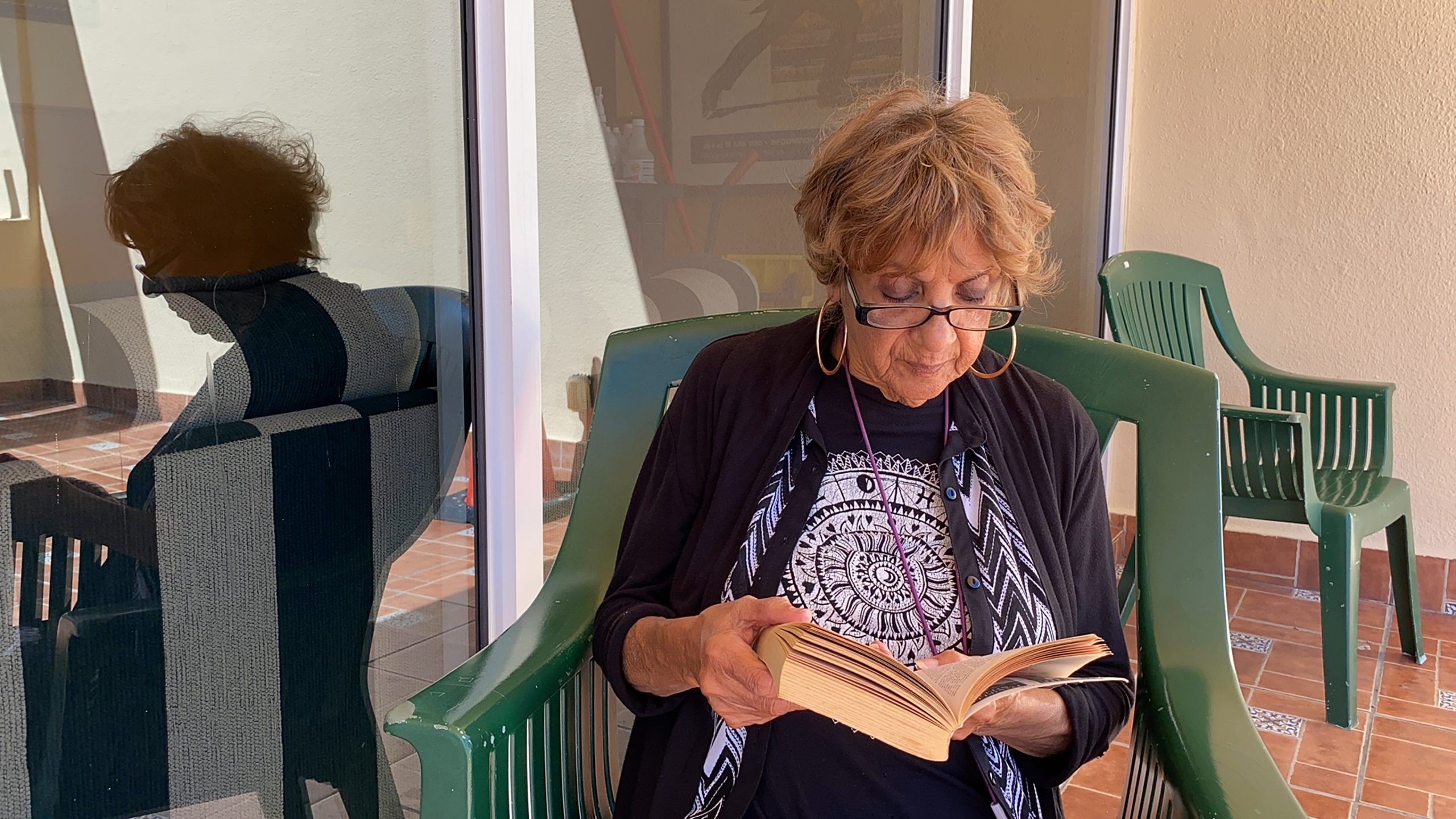 Priscilla Martinez enjoys reading on the rooftop deck of Four Freedoms House.